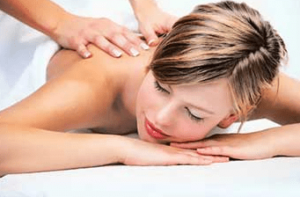 Home page picture of a lady receiving an upper back massage.